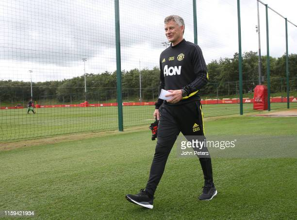 Manager Ole Gunnar Solskjaer of Manchester United walks out ahead of a first team training session at Aon Training Complex on July 01, 2019 in...