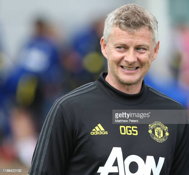 Manager Ole Gunnar Solskjaer of Manchester United walks out ahead of a first team training session at Aon Training Complex on July 01 2019 in...