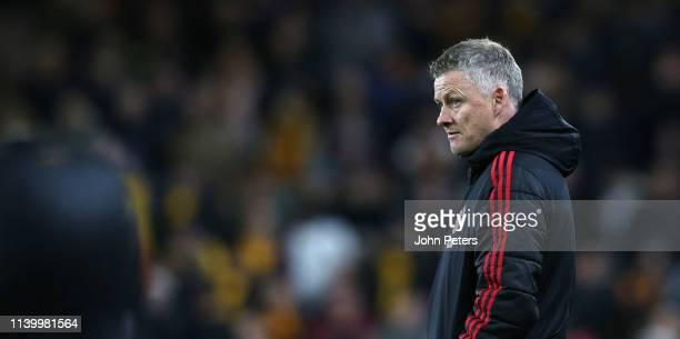 Manager Ole Gunnar Solskjaer of Manchester United watches from the touchline during the Premier League match between Wolverhampton Wanderers and...