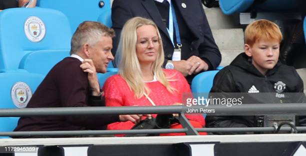 Manager Ole Gunnar Solskjaer of Manchester United watches from the stand during the Barclays FA Women's Super League match between Manchester City...