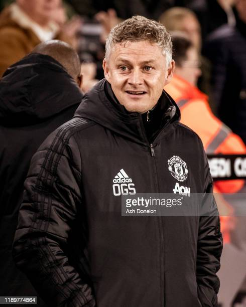 Manager Ole Gunnar Solskjaer of Manchester United watches from the touchline ahead of the Premier League match between Sheffield United and...