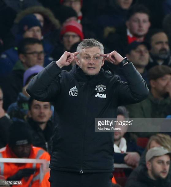 Manager Ole Gunnar Solskjaer of Manchester United watches from the touchline during the Premier League match between Arsenal FC and Manchester United...