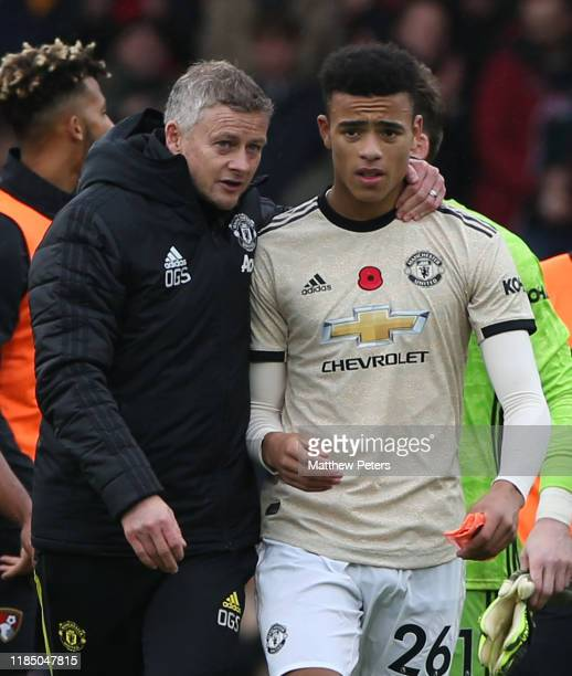 Manager Ole Gunnar Solskjaer of Manchester Unitedspeaks to Mason Greenwood after the Premier League match between AFC Bournemouth and Manchester...