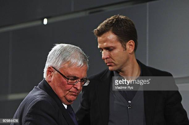 Manager Oliver Bierhoff and president Theo Zwanziger leave the press conference of the German national football team due to the death of Robert Enke...