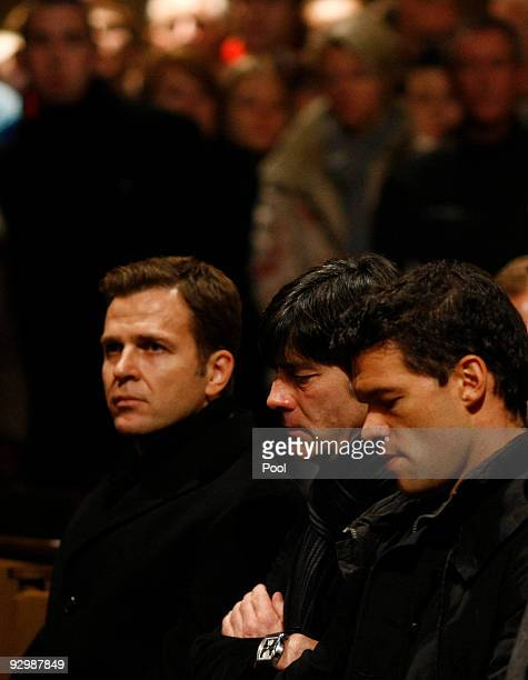 Manager Oliver Bierhoff, head coach Joachim Loew of the German National Team and Michael Ballack attend a church service for Germany's national...