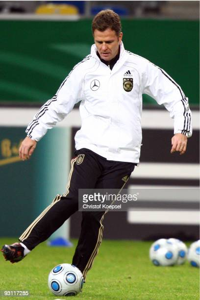 Manager Oliver Bierhoff of Germany runs with the ball during a German National team training session at the Esprit Arena on November 17 2009 in...