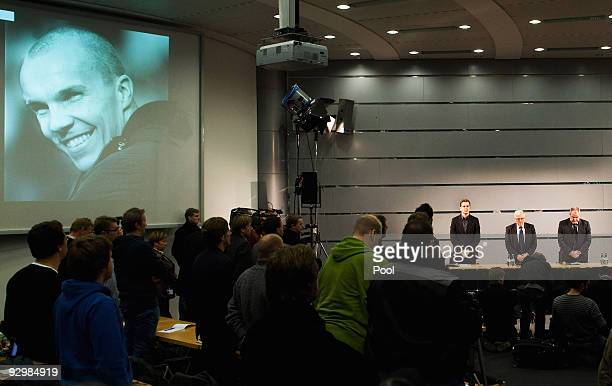 Manager Oliver Bierhoff president Theo Zwanziger press officer Harald Stenger and media representatives hold a minute of silence for Robert Enke...