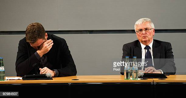 Manager Oliver Bierhoff wipes away his tears as president Theo Zwanziger looks on during the press conference of the German national football team...