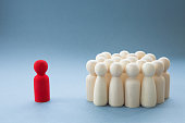 A Manager or Leader addressing a group of people or being isolated because of diversity