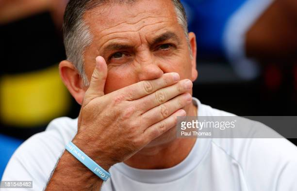 Manager Owen Coyle of Wigan watches on during the Sky Bet Championship match between Wigan Athletic and Ipswich Town at the DW Stadium on September...