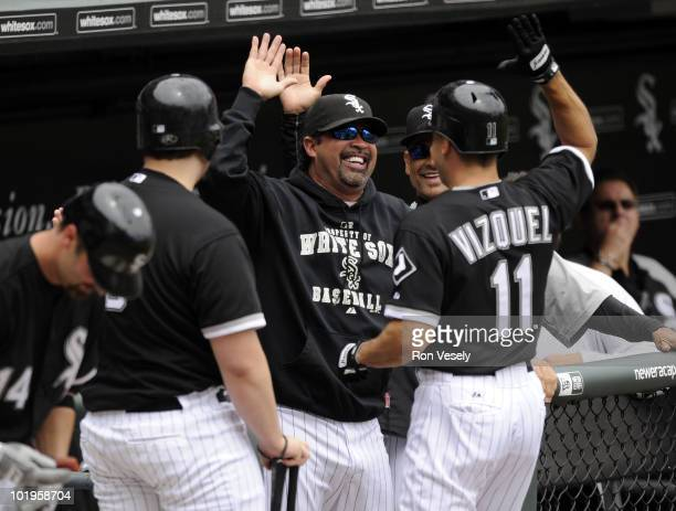 Manager Ozzie Guillen greets Omar Vizquel of the Chicago White Sox after Vizquel hit a home run against the Detroit Tigers on June 10 2010 at US...
