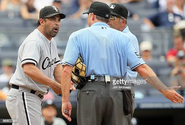 Manager Ozzie Guillen of the Chicago White Sox argues with home plate umpire Dan Iassogna and first base umpire Dale Scott after being ejected from...