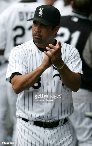 Manager Ozzie Guillen of the Chicago White Sox encourages his team in the dugout during a game against the Toronto Blue Jays on August 4 2005 at US...