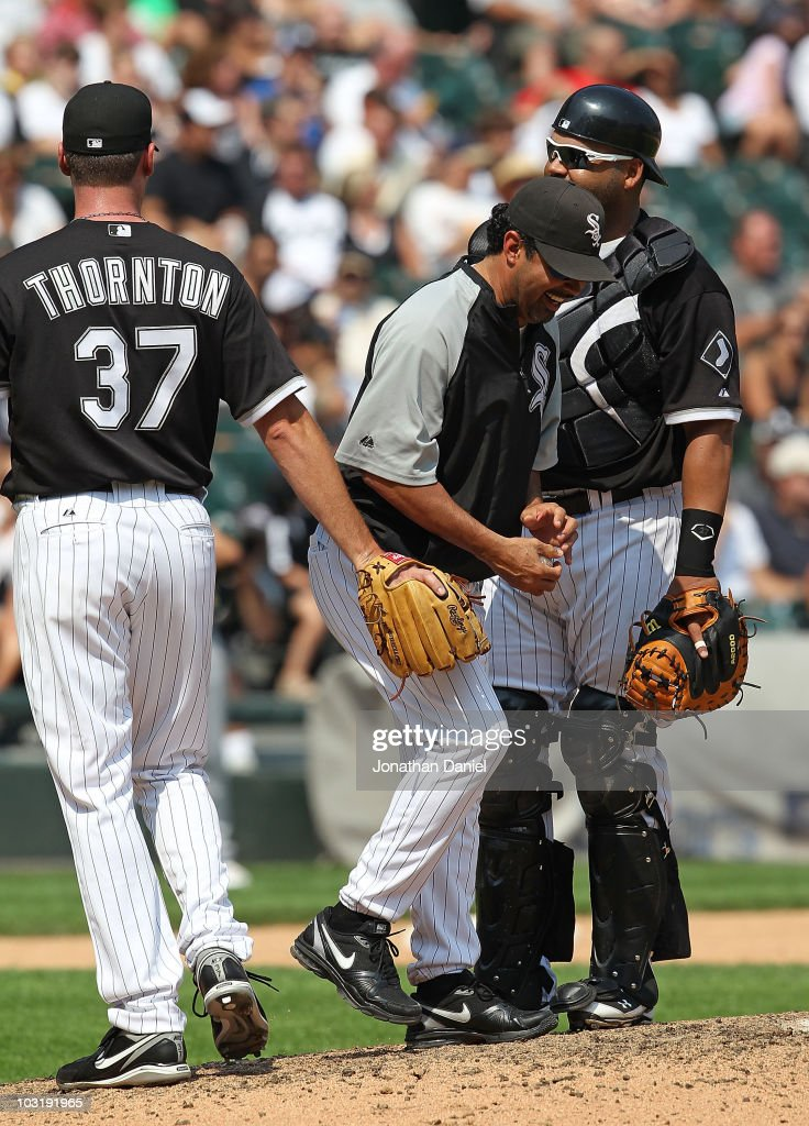 Manager Ozzie Guillen #13 of the Chicago White Sox laughs after being swiped by pitcher Matt Thorton #37 after taking Thorton out of a game as Ramon Castro #27 watches in the 8th inning against the Oakland Athletics at U.S. Cellular Field on August 1, 2010 in Chicago, Illinois. The White Sox defeated the Athletics 4-1.