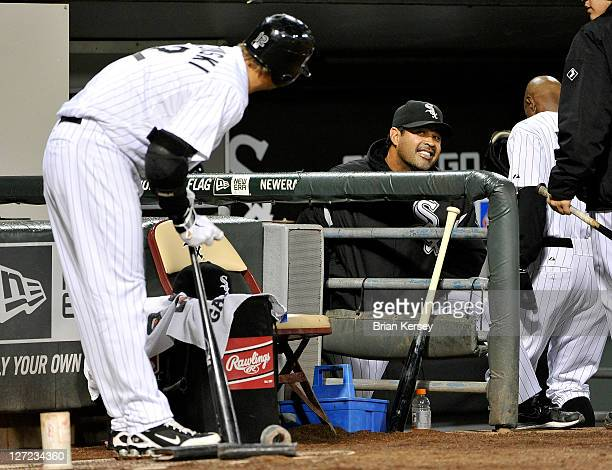 Manager Ozzie Guillen of the Chicago White Sox smiles at AJ Pierzynski as they play the Toronto Blue Jays at U S Cellular Field on September 26 2011...