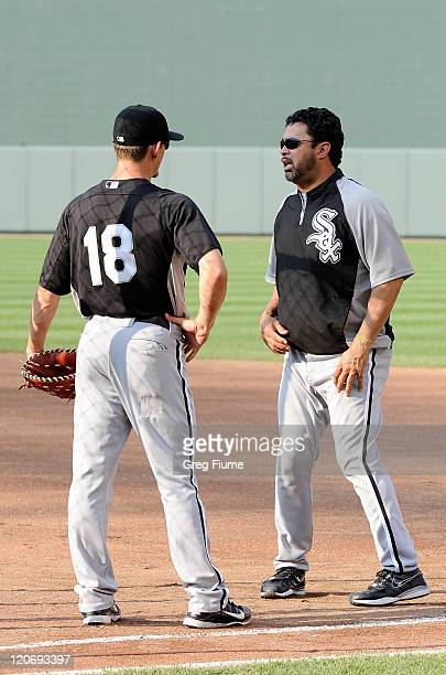 Manager Ozzie Guillen of the Chicago White Sox talks to Brent Lillibridge before the game against the Baltimore Orioles at Oriole Park at Camden...