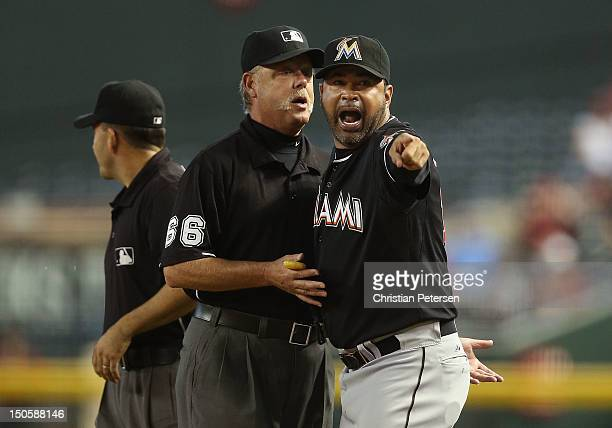 Manager Ozzie Guillen of the Miami Marlins argues with second base umpire Jim Joyce after being ejected during the third inning of game one of the...