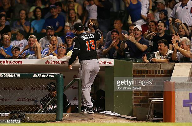 Manager Ozzie Guillen of the Miami Marlins gives a thumbs up to the crowd during a game against the Chicago Cubs at Wrigley Field on July 17 2012 in...