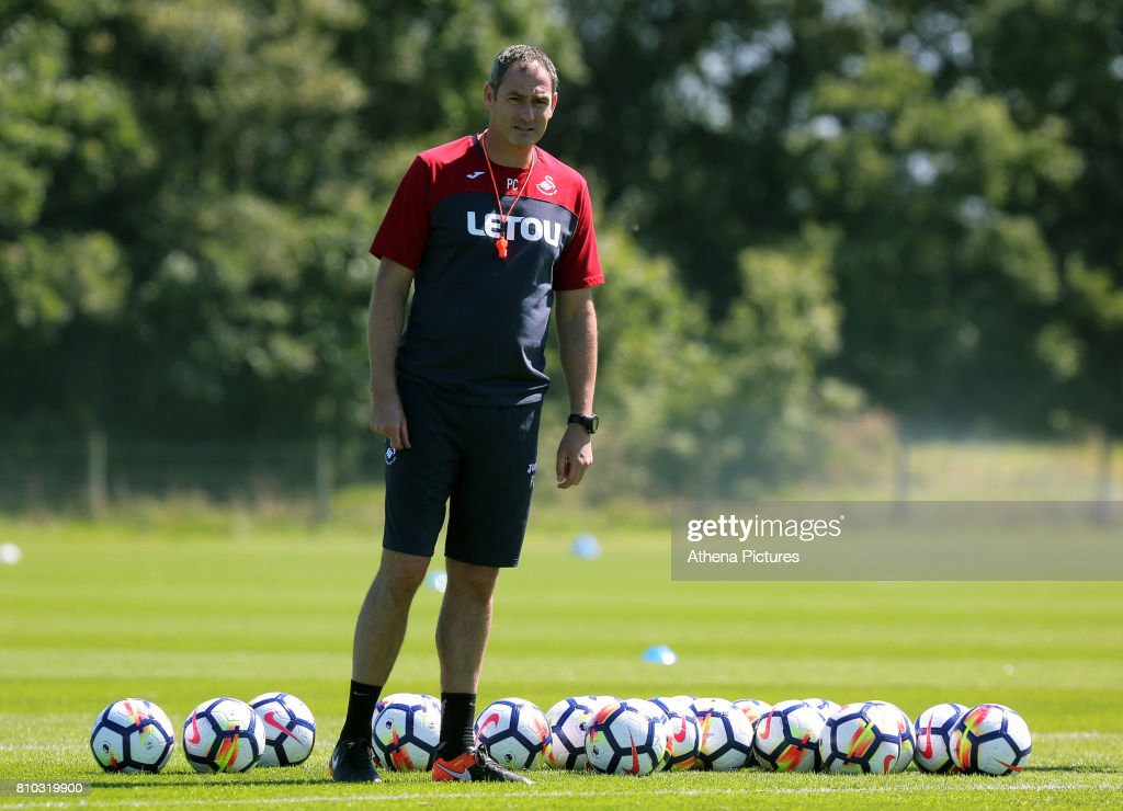 Manager Paul Clement watches his players train during the Swansea City Training at The Fairwood Training Ground on July 5, 2017 in Swansea, Wales.