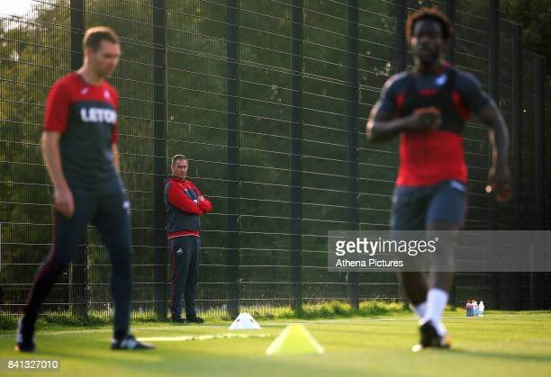 Manager Paul Clement watches on as Wilfried Bony goes through his medical at the Swansea City FC Fairwood Training Ground on August 31 2017 in...