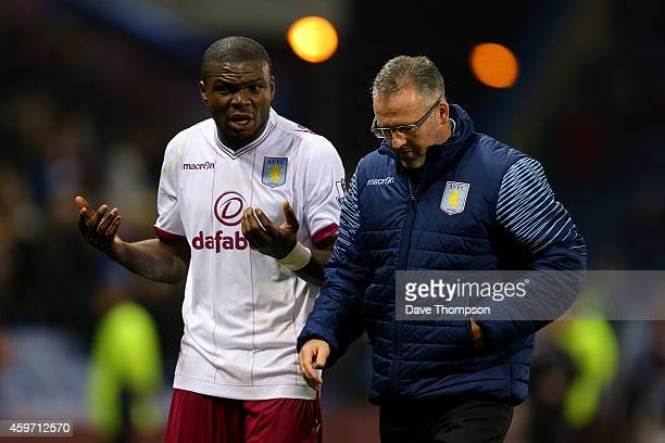 Manager Paul Lambert of Aston Villa speaks with Jores Okore after the Barclays Premier League match between Burnley and Aston Villa at Turf Moor on...