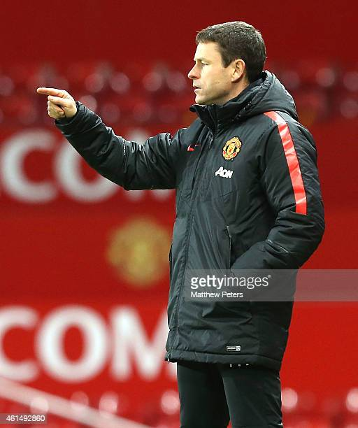 Manager Paul McGuinness of Manchester United U18s watches from the touchline during the FA Youth Cup Fourth Round match between Manchester United...