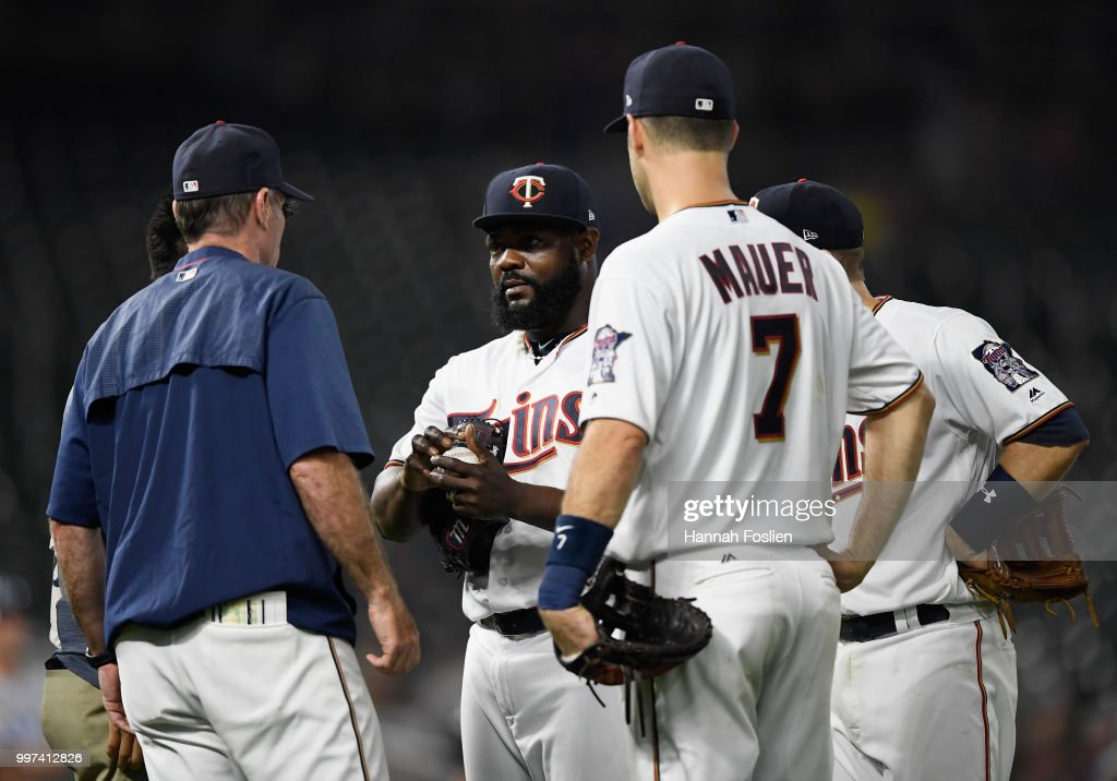 Manager Paul Molitor #4 and Joe Mauer #7 of the Minnesota Twins check on Fernando Rodney #56 after being hit by the ball during the ninth inning of the game against the Tampa Bay Rays on July 12, 2018 at Target Field in Minneapolis, Minnesota. The Twins defeated the Rays 5-1.