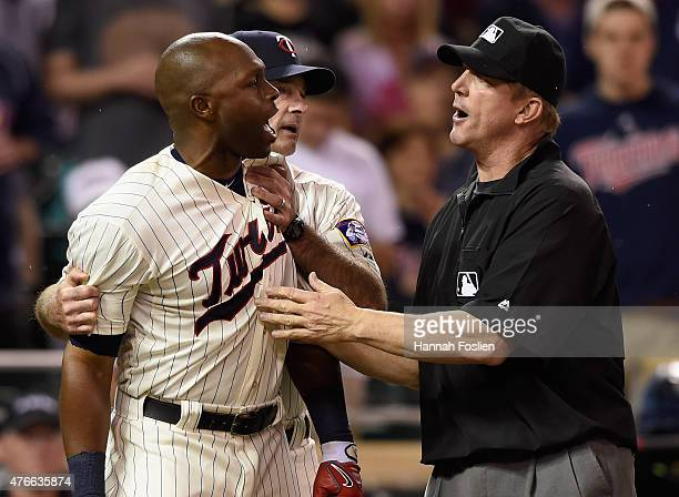 Manager Paul Molitor of the Minnesota Twins and first base umpire Jeff Kellogg get between Torii Hunter and home plate umpire Mark Ripperger after...