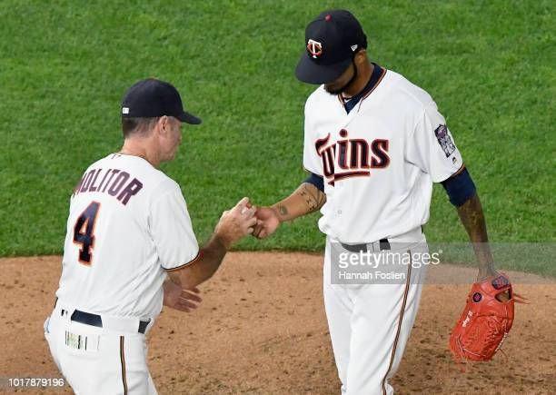 Manager Paul Molitor of the Minnesota Twins takes the ball from Ervin Santana during the fifth inning of the game against the Detroit Tigers on...