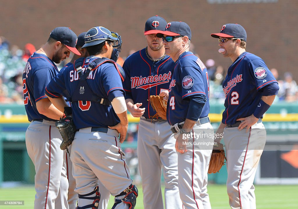 Manager Paul Molitor #4 of the Minnesota Twins talks with his players on the pitchers mound during the game against the Detroit Tigers at Comerica Park on May 14, 2015 in Detroit, Michigan. The Tigers defeated the Twins 13-1.