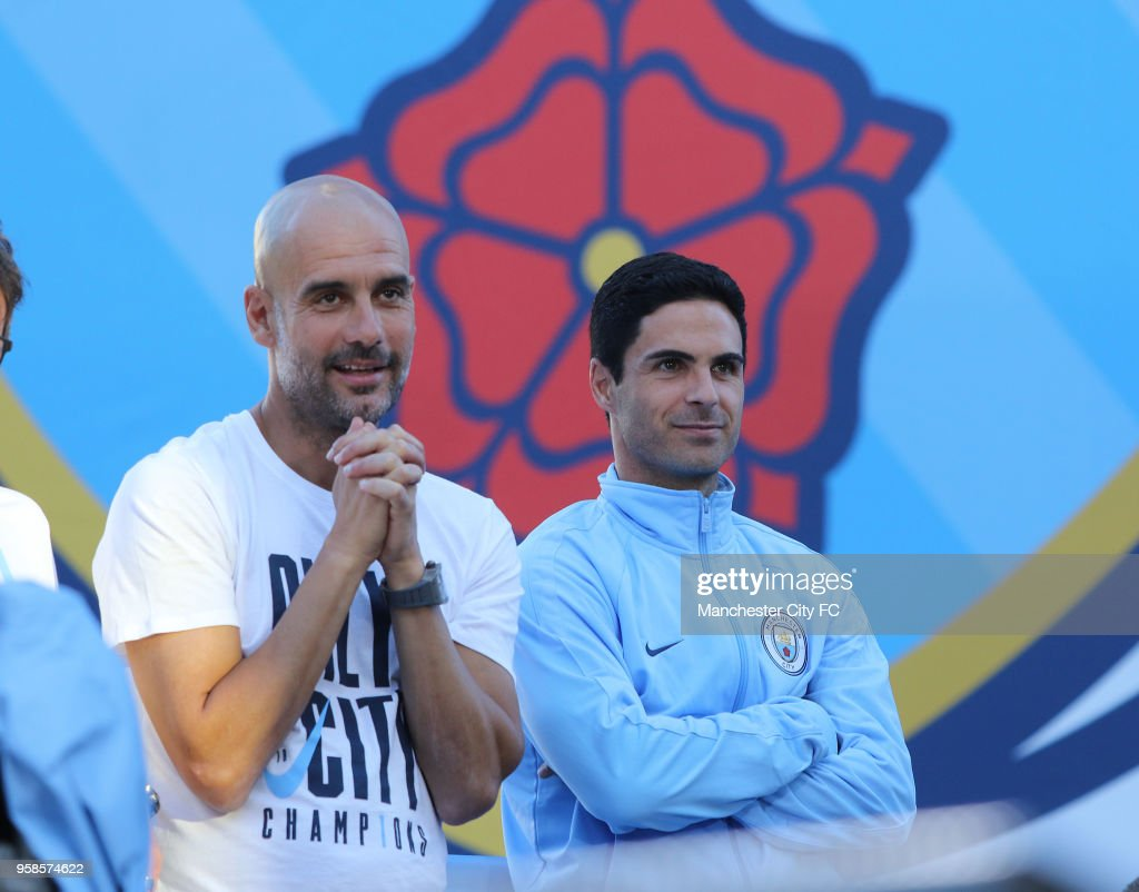 Manager Pep Gaudiola watches his players on stage after a victory Parade by Manchester City FC on May 14, 2018 in Manchester, England.