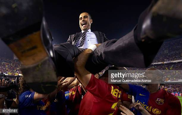 Manager Pep Guardiola of Barcelona is lifted after the Copa del Rey final match between Barcelona and Athletic Bilbao at the Mestalla stadium on May...
