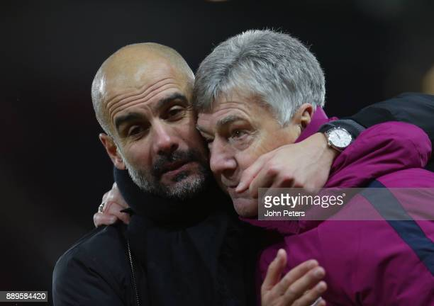 Manager Pep Guardiola of Manchester City celebrates with Brian Kidd after the Premier League match between Manchester United and Manchester City at...