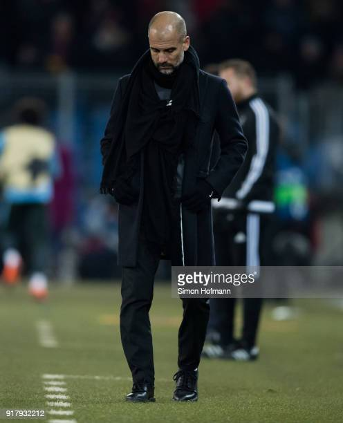 Manager Pep Guardiola of Manchester City looks down during the UEFA Champions League Round of 16 First Leg match between FC Basel and Manchester City...