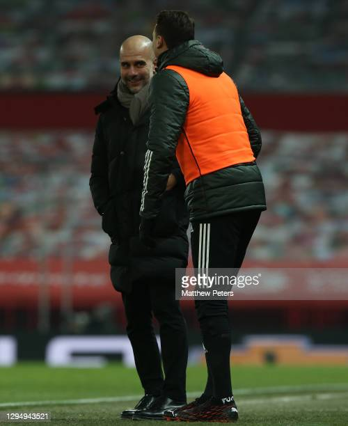 Manager Pep Guardiola of Manchester City talks to Nemanja Matic of Manchester United during the Carabao Cup Semi Final between Manchester United and...