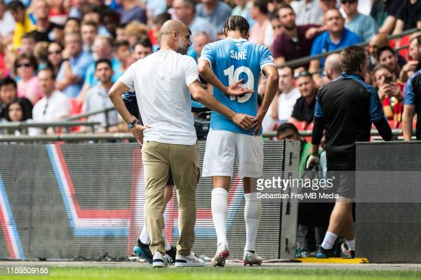 Manager Pep Guardiola of Manchester City with Leroy Sane of Manchester City as he is taken off with an injury during the FA Community Shield match...