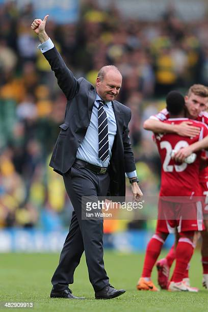 Manager Pepe Mel of West Brom celebrates their victory after the Barclays Premier League match between Norwich City and West Bromwich Albion at...