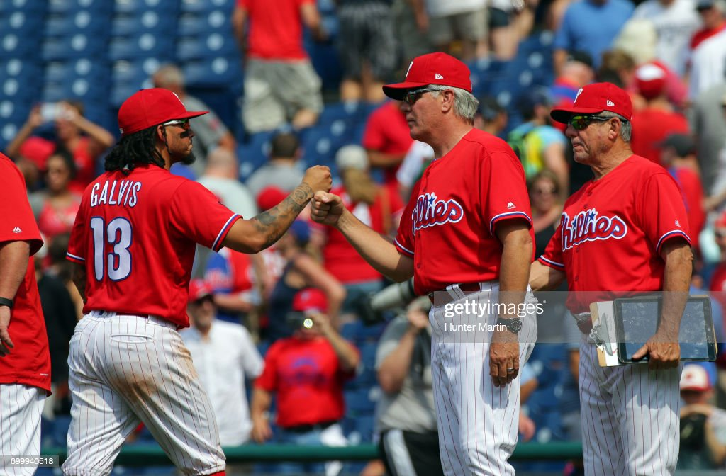 Manager Pete Mackanin #45 of the Philadelphia Phillies congratulates Freddy Galvis #13 after winning a game against the St. Louis Cardinals at Citizens Bank Park on June 22, 2017 in Philadelphia, Pennsylvania. The Phillies won 5-1.