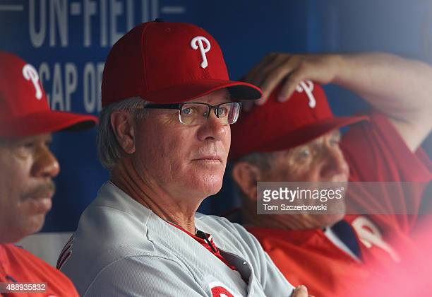 Manager Pete Mackanin of the Philadelphia Phillies dand bench coach Larry Bowa look on from the dugout during MLB game action against the Toronto...