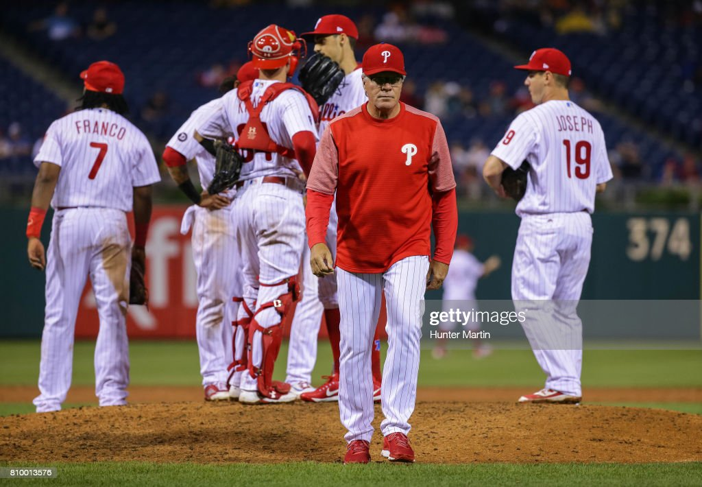 Manager Pete Mackanin #45 of the Philadelphia Phillies walks to the dugout after making a pitching change in the ninth inning during a game against the Pittsburgh Pirates at Citizens Bank Park on July 6, 2017 in Philadelphia, Pennsylvania. The Pirates won 6-3.