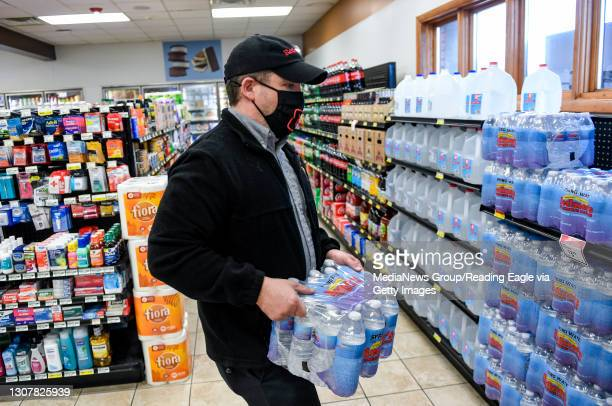 Manager Pete Ostrowski carries a case of bottled water at the Redner's Quick Shoppe on Tuckerton Road in Muhlenberg township Thursday afternoon March...