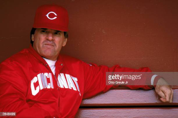 Manager Pete Rose of the Cincinnati Reds sits in the dugout during the game against the San Francisco Giants at Candlestick Park during the 1989 MLB...