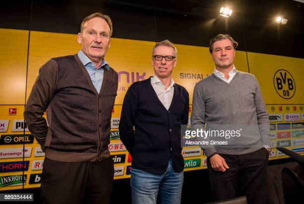 Manager Peter Stoeger is presented as the new head coach of Borussia Dortmund during the press conference with HansJoachim Watzke l and Michael Zorc...