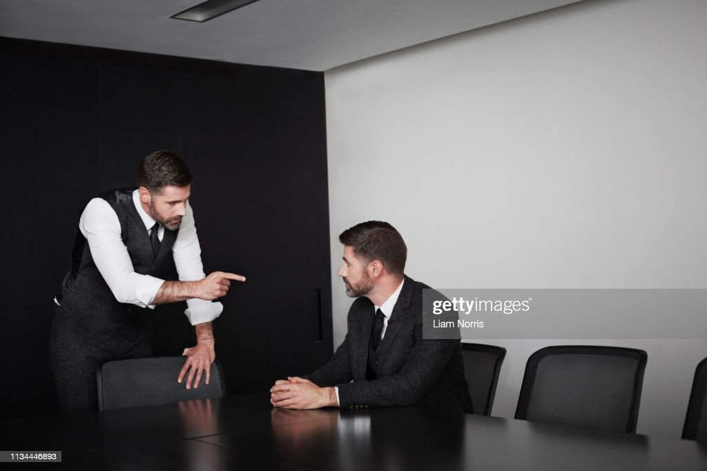 Manager pointing at employee, multiple image : Stock Photo