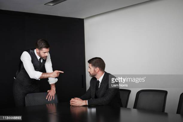 manager pointing at employee, multiple image - being fired photos stock pictures, royalty-free photos & images