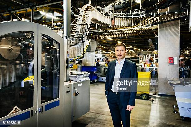 Manager portrait in huge factory