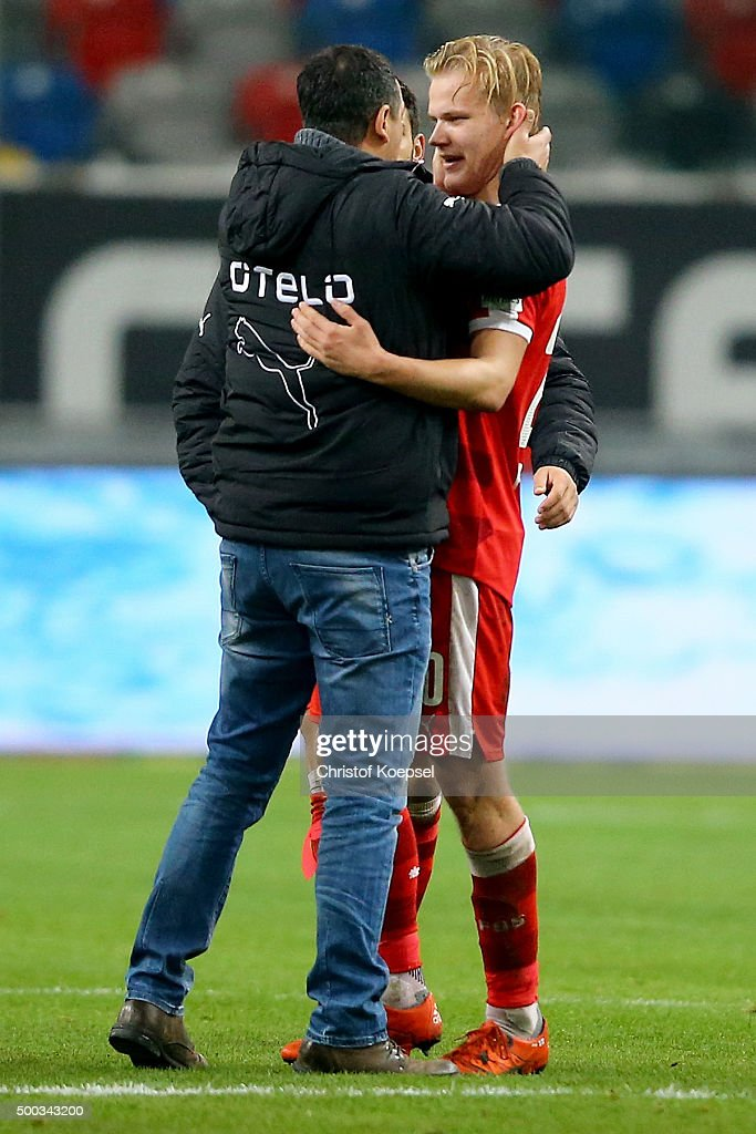 Manager Rachid Azzouzi of Duesseldorf (L) embraces Joel Pohjanpalo of Duesseldorf who scored the decision goal after the Second Bundesliga match between Fortuna Duesseldorf and Eintracht Braunschweig at Esprit-Arena on December 7, 2015 in Duesseldorf, Germany.
