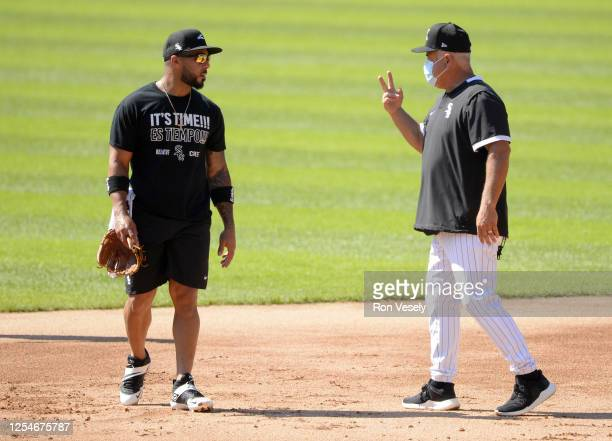 Manager Rick Renteria instructs Leury Garcia of the Chicago White Sox fields during summer workouts as part of Major League Baseball Spring Training...