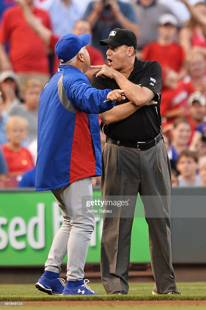 Manager Rick Renteria #16 of the Chicago Cubs argues a foul ball call with third base umpire Andy Fletcher #49 in the fifth inning against the Cincinnati Reds at Great American Ball Park on July 9, 2014 in Cincinnati, Ohio. Fletcher was ejected from the game and Cincinnati defeated Chicago 4-1.