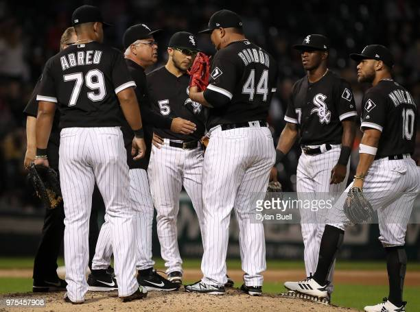 Manager Rick Renteria of the Chicago White Sox checks on Bruce Rondon in the eighth inning against the Cleveland Indians at Guaranteed Rate Field on...